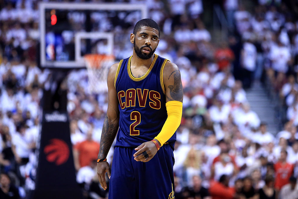 Kyrie Irving of the Cleveland Cavaliers reacts in the third quarter against the Toronto Raptors.