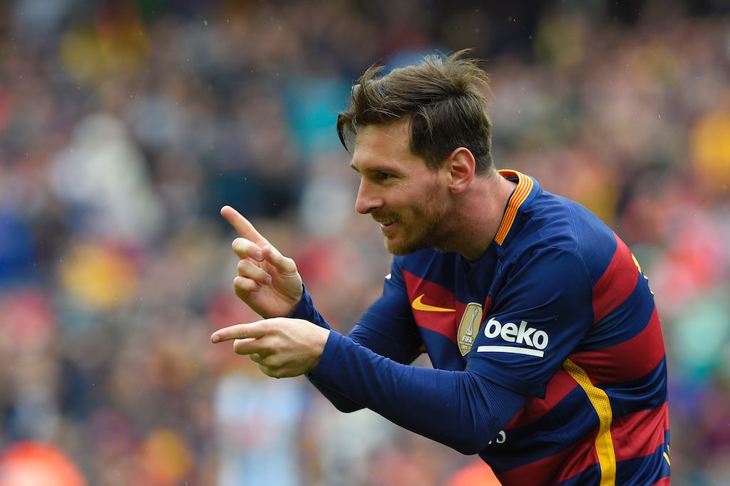 Lionel Messi celebrates after scoring a goal. | LLUIS GENE/AFP/Getty Images