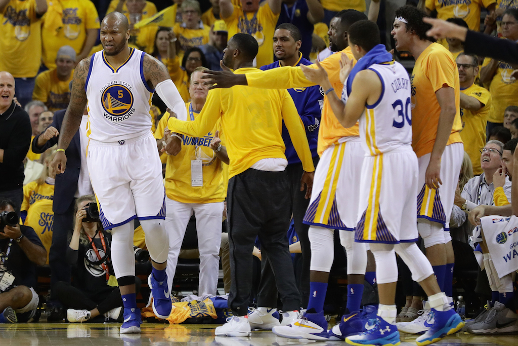 Marreese Speights #5 is applauded by teammates during Game 5 of the WCF. | Ezra Shaw/Getty Images