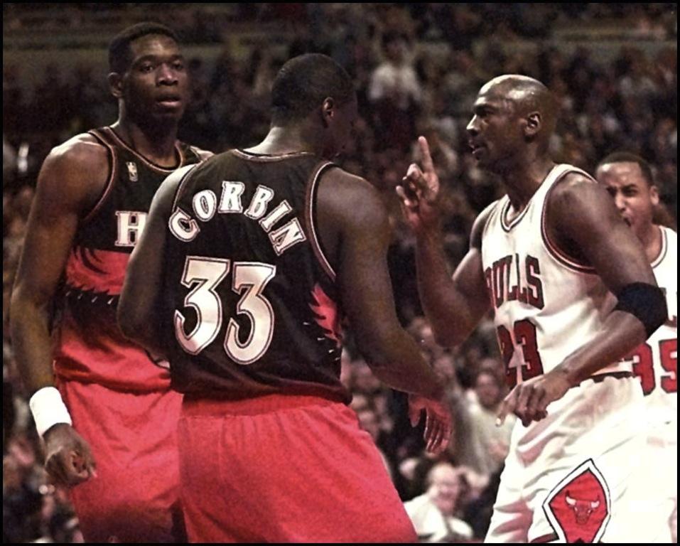Michael Jordan waves his finger at Dikembe Mutombo.