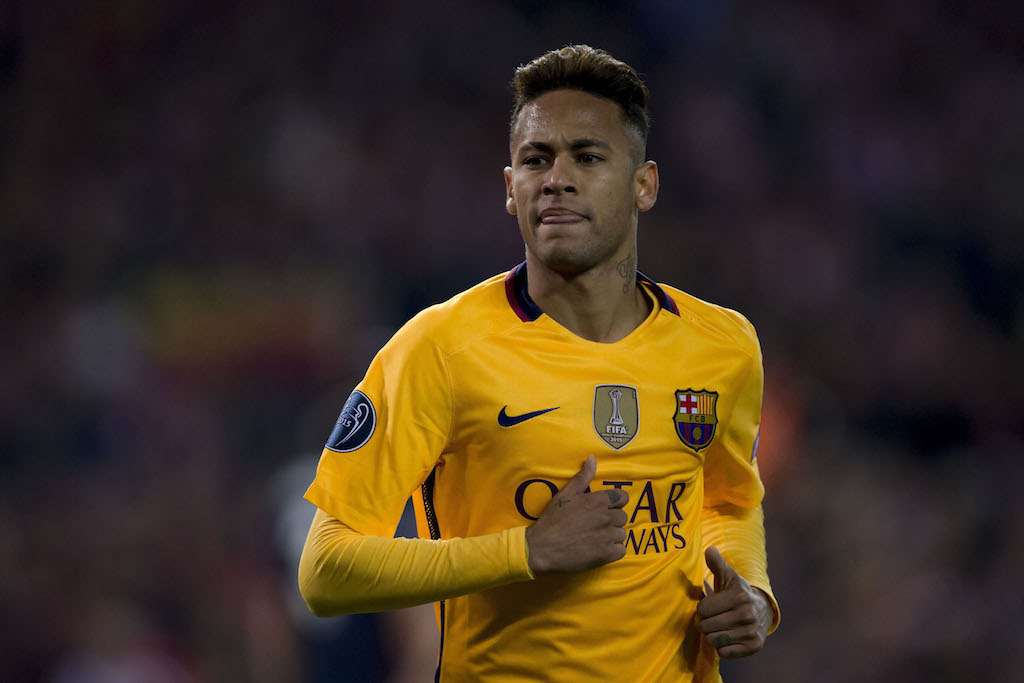 Neymar jogs across the field during a game.