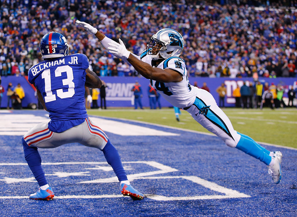 Odell Beckham #13 of the New York Giants scores a game tying touchdown against Josh Norman #24 of the Carolina Panthers in the fourth Quarter during their game at MetLife Stadium on December 20, 2015 in East Rutherford, New Jersey.
