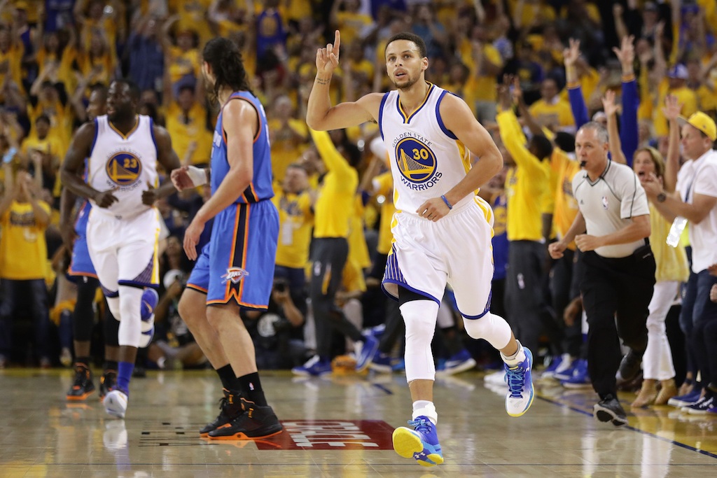 Stephen Curry reacts after knocking down a big triple. | Ezra Shaw/Getty Images