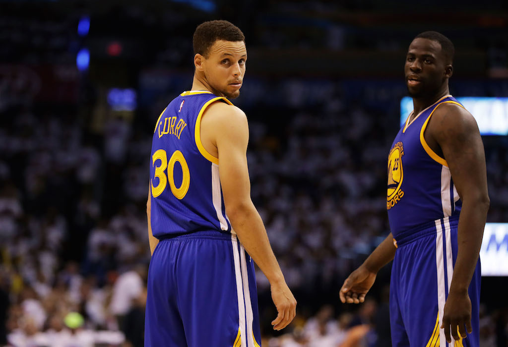 Stephen Curry and Draymond Green react during Game 4 of the WCF.