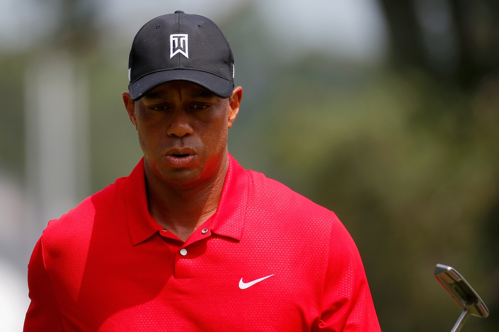 Tiger Woods reacts after a putt.