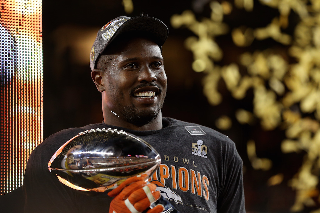 Von Miller holds the MVP trophy after Super Bowl 50.