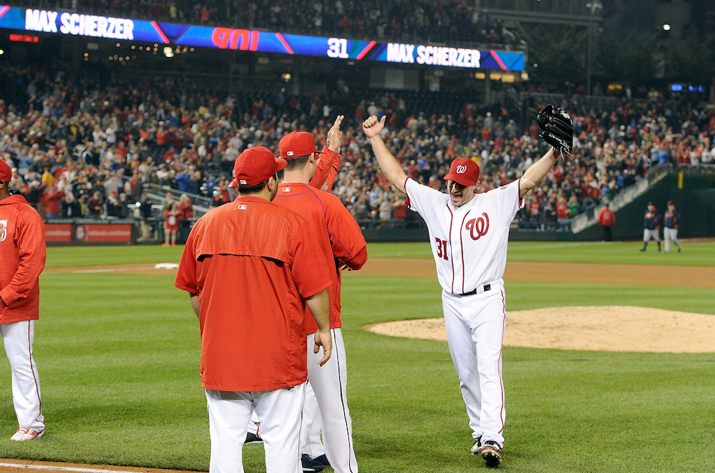 Max Scherzer is congratulated by teammates after his 20-strikeout game.