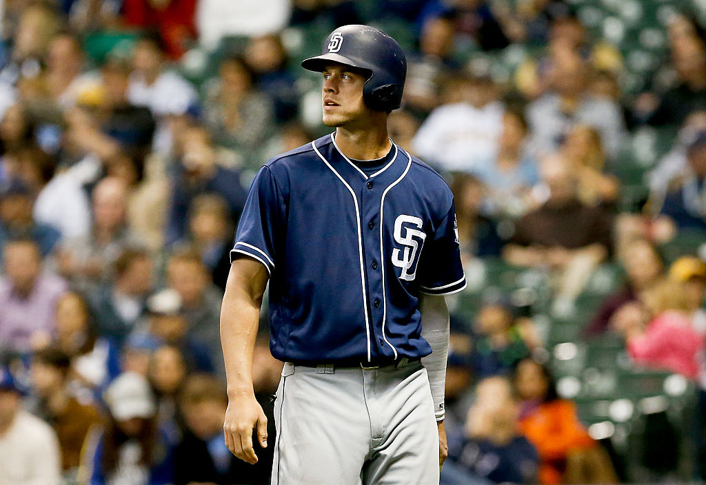 Wil Myers of the San Diego Padres walks back to the dugout after striking out.