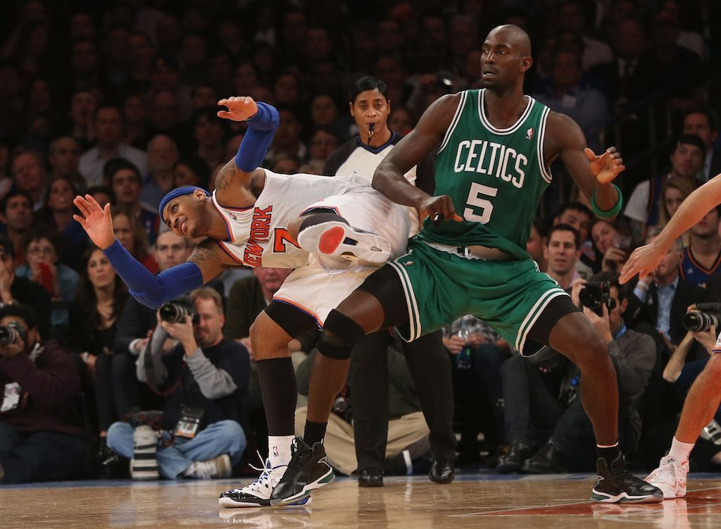 Carmelo Anthony tries to defend against a member of the opposing team.