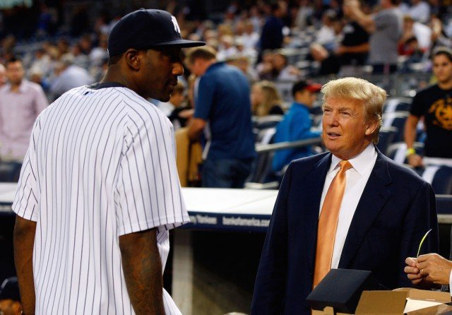 Donald Trump (R) chats with Amar'e Stoudemire before the start of a Yankees game.