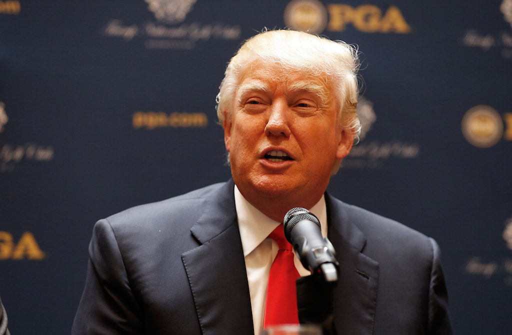Donald Trump speaks to the media about a partnership with the PGA.