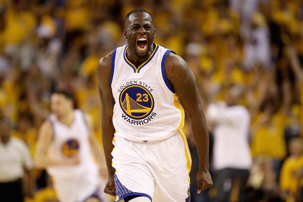 Draymond Green shouts during a game while playing for the Golden State Warriors