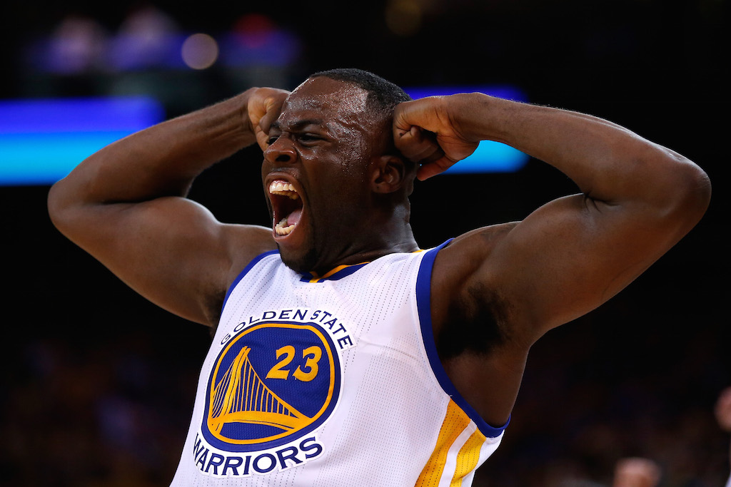 Draymond Green pumps up the crowd during a Golden State Warriors game