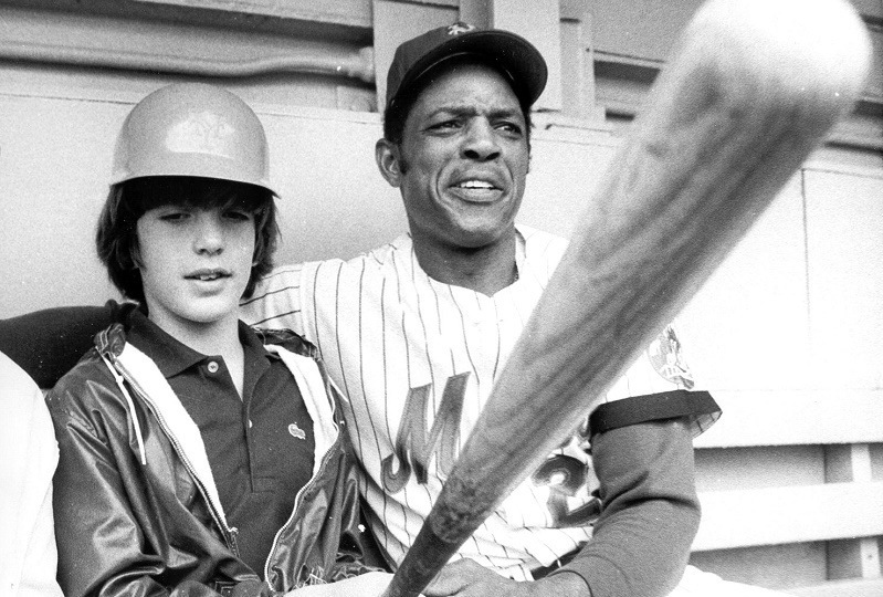 John F. Kennedy Jr (L) is seen with Mets baseball player Willie Mays at Shea Stadium in New York 03 June 1972. Kennedy, his wife Caroline Bessette Kennedy and her sister Lauren Bessette are missing after the airplane they were in failed to arrive 16 July at Martha's Vineyard.