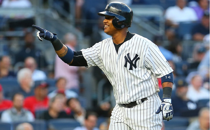 Starlin Castro of the New York Yankees celebrates after hitting a solo home run.