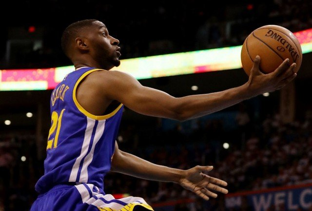 The Golden State Warriors' Ian Clark goes in for the layup.
