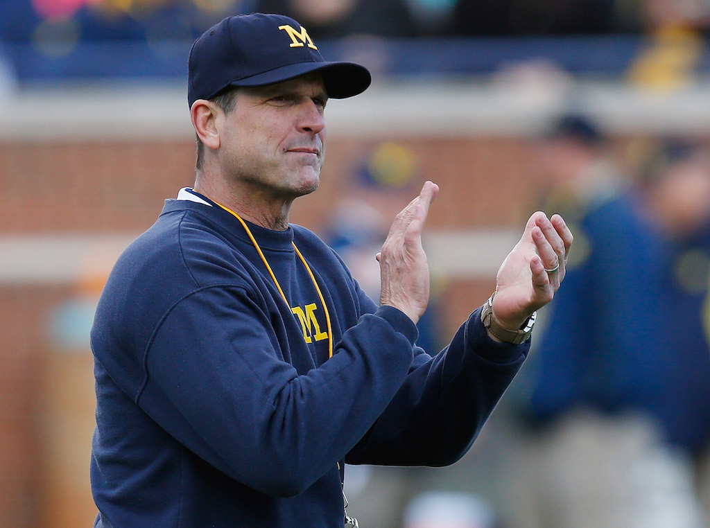 Head coach Jim Harbaugh of the Michigan Wolverines looks on prior to a game.