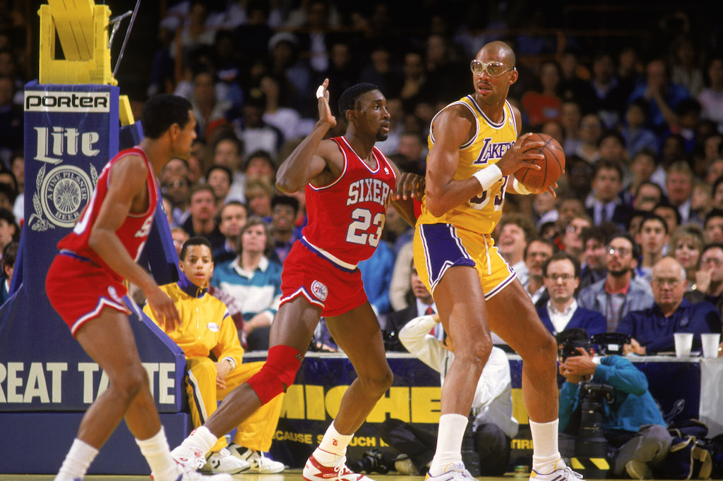 Kareem Abdul-Jabbar looks to pass the ball.