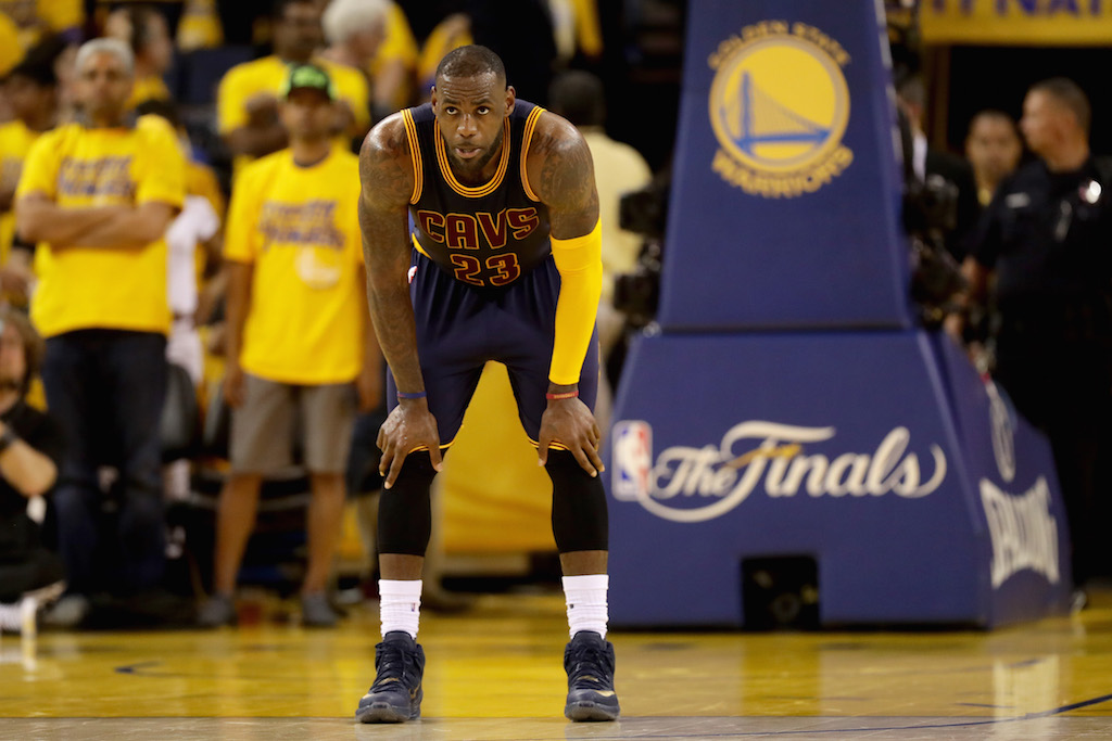LeBron James looks on during Game 2 of the 2016 NBA Finals. | Ezra Shaw/Getty Images