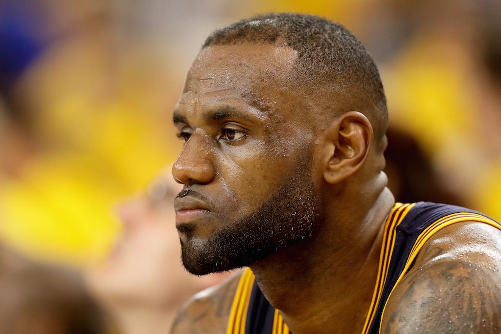 "LeBron James listens to ""Sandstorm"" | Ezra Shaw/Getty Images"
