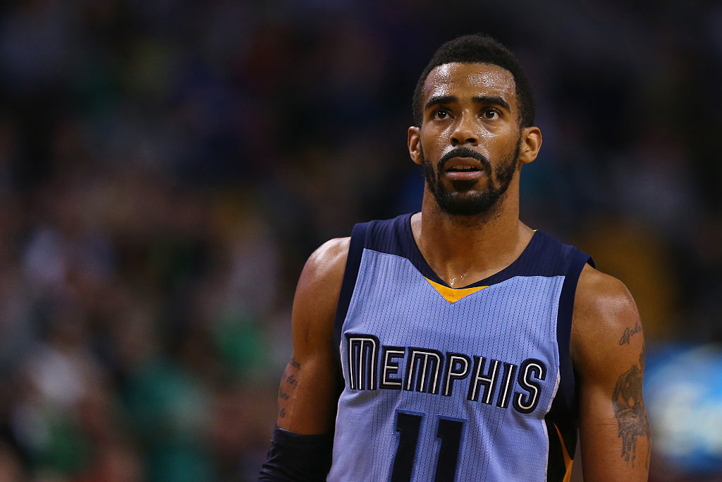 Mike Conley #11 of the Memphis Grizzlies looks on during the game against the Memphis Grizzlies at TD Garden on March 11, 2015 in Boston, Massachusetts.