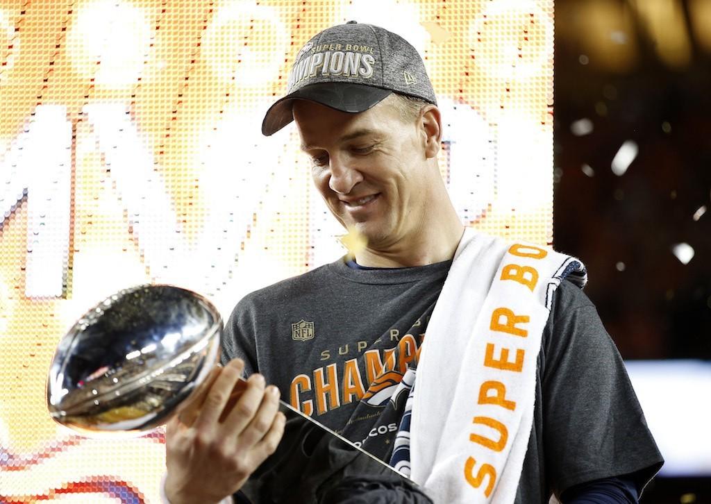 Peyton Manning admires his Super Bowl trophy.