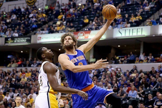 Robin Lopez #8 of the New York Knicks shoots the ball during the game against the Indiana Pacers at Bankers Life Fieldhouse on April 12, 2016 in Indianapolis, Indiana. NOTE TO USER: User expressly acknowledges and agrees that, by downloading and or using this photograph, User is consenting to the terms and conditions of the Getty Images License Agreement. (Photo by Andy Lyons/Getty Images)