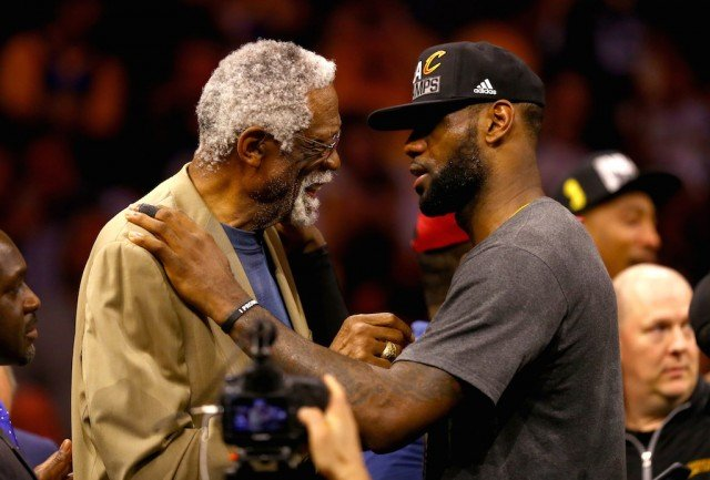 Bill Russell (L) and LeBron James embrace.