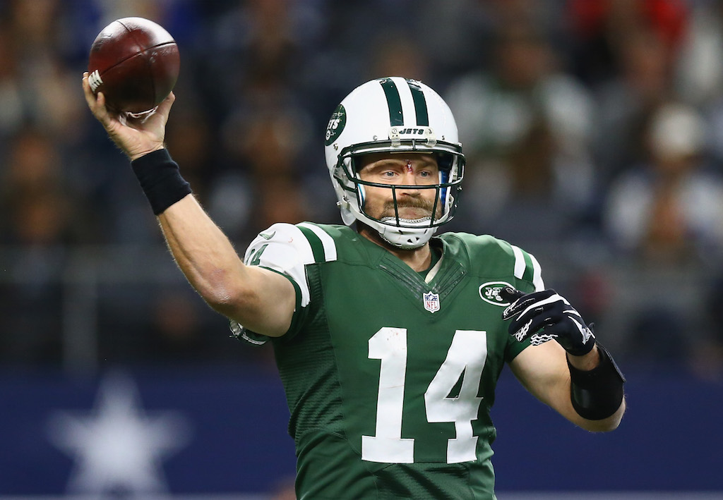 Ryan Fitzpatrick grips the football and looks for a target.