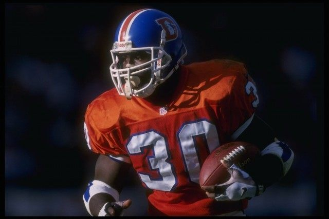 Terrell Davis runs the ball for the Broncos