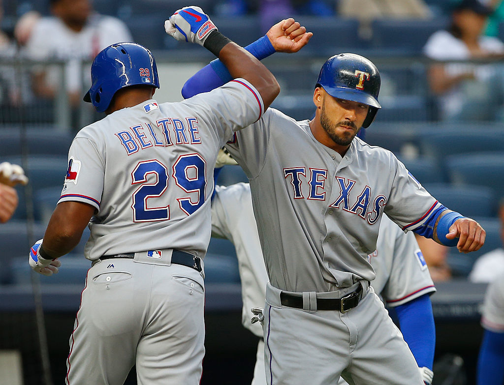 Adrian Beltre #29 of the Texas Rangers is congratulated by Ian Desmond #20. | Rich Schultz/Getty Images