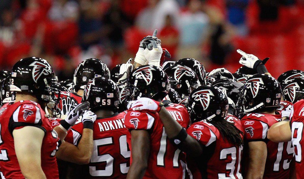 The Atlanta Falcons huddle up to begin a game.