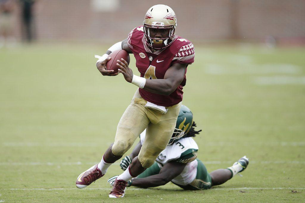 Dalvin Cook #4 of the Florida State Seminoles runs for a 24-yard touchdown against the South Florida Bulls.