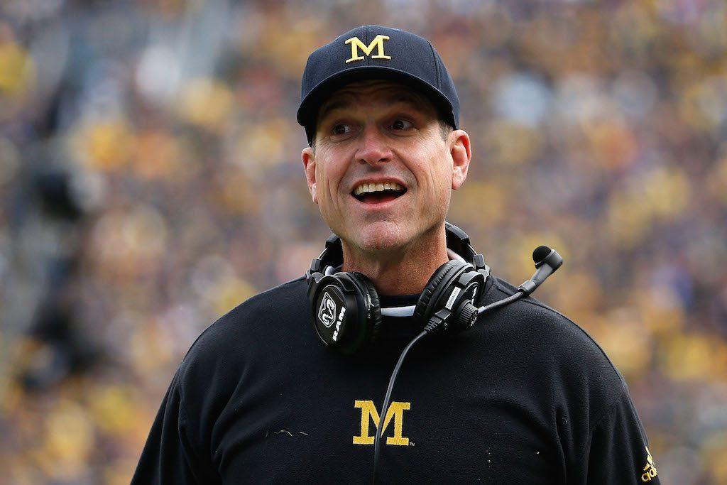 Head coach Jim Harbaugh of the Michigan Wolverines celebrates a touchdown.