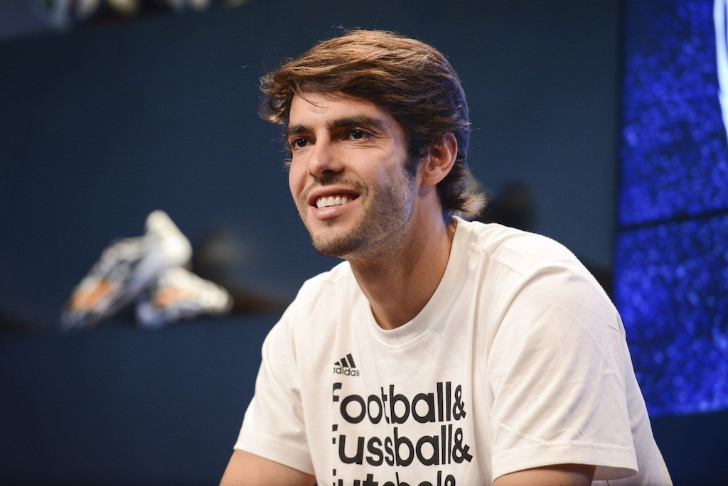Kaká doing work at a press conference.