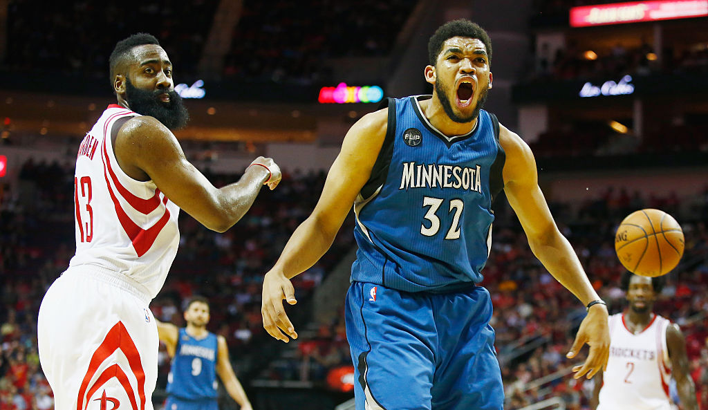Karl-Anthony Towns #32 of the Minnesota Timberwolves reacts to a call in front of James Harden #13 of the Houston Rockets on the court during their game at the Toyota Center on March 18, 2016 in Houston, Texas. | Scott Halleran/Getty Images