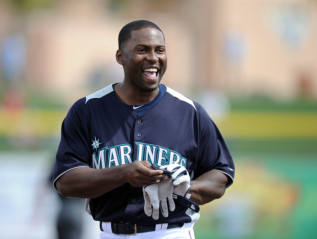 Milton Bradley of the Seattle Mariners smiles as he leaves the field