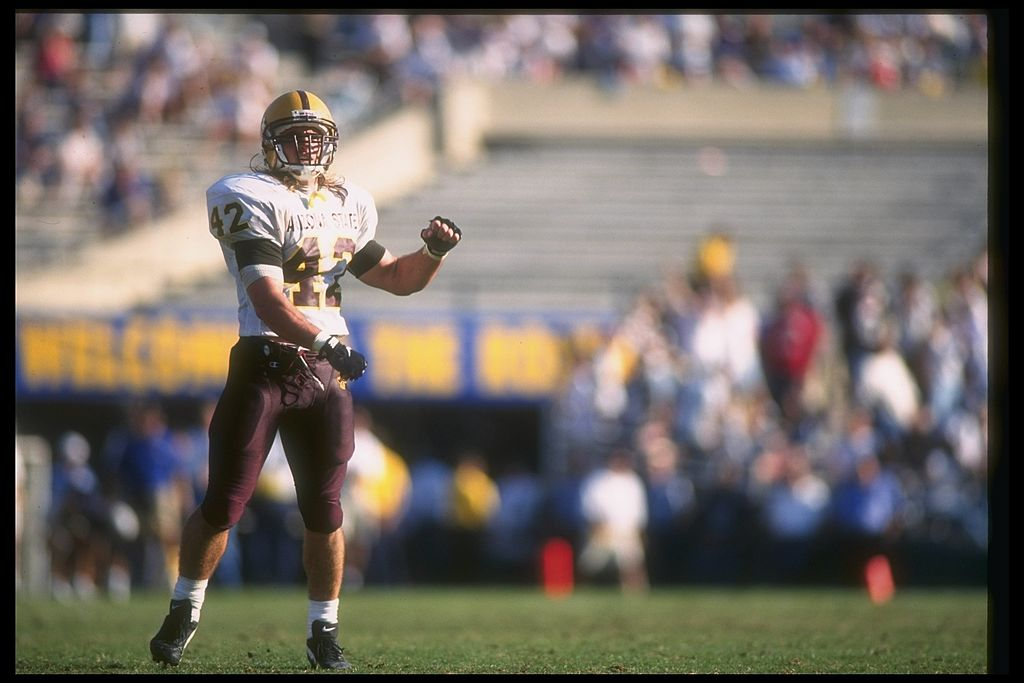 The late Pat Tillman, formerly of the Arizona State Sun Devils, throws for a touchdown.