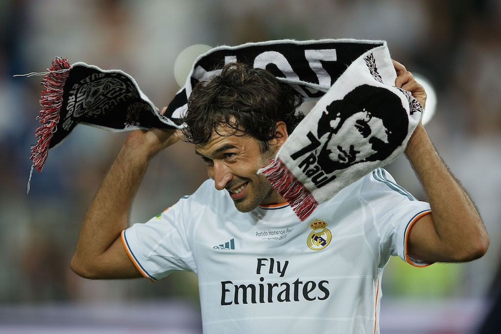 Raul wraps his namesake scarf around his neck.