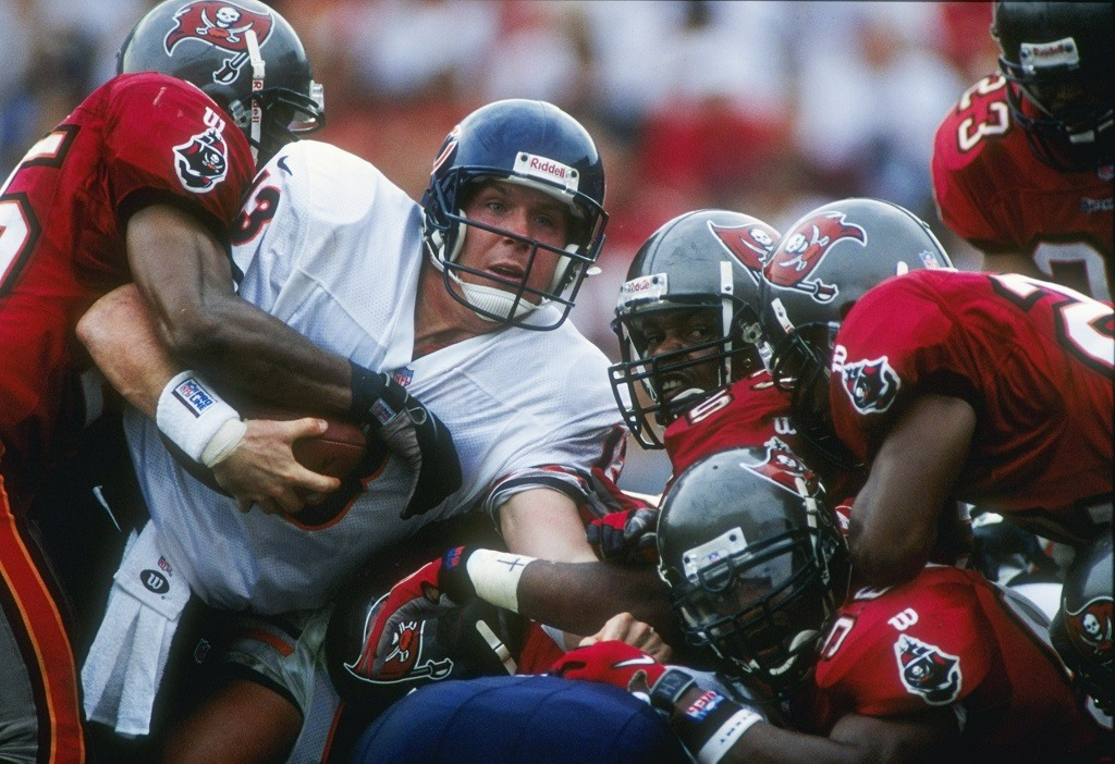 21 Dec 1997: Quarterback Rick Mirer of the Chicago Bears is mobbed by the Tampa Bay Buccaneers defense during the Bears 31-15 loss at Houlihan''s Stadium in Tampa, Florida. Mandatory Credit: Scott Halleran /Allsport