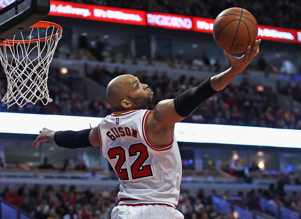 Taj Gibson of the Chicago Bulls tries to grab a rebound against the Los Angeles Lakers.