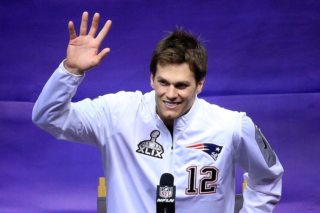 Tom Brady waves at the crowd.