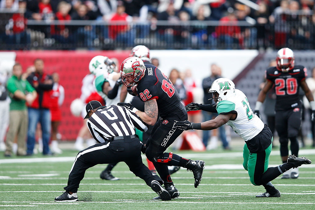 Tyler Higbee #82 of the Western Kentucky Hilltoppers runs into umpire Sheldon Davis after a reception against the Marshall Thundering Herd in the first half of the game at L.T. Smith Stadium on November 27, 2015 in Bowling Green, Kentucky. (Photo by Joe Robbins/Getty Images)