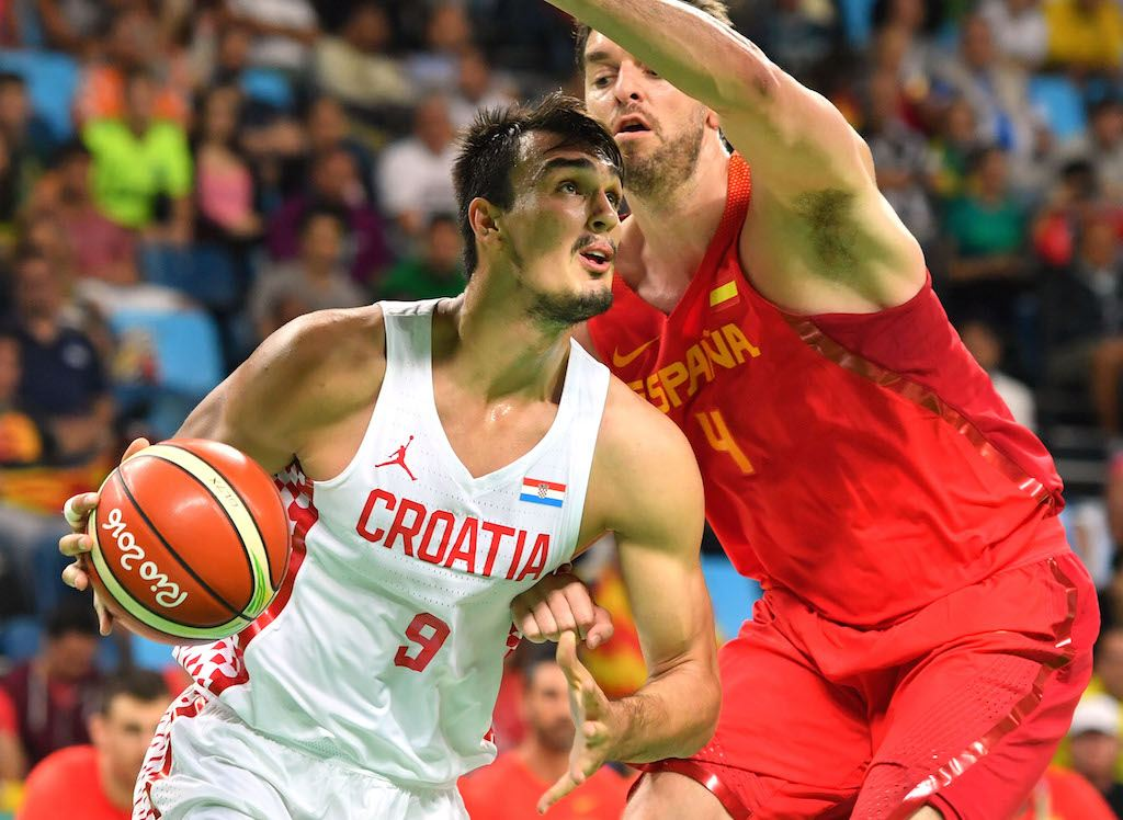 Croatia's Dario Saric drives on Pau Gasol of Spain