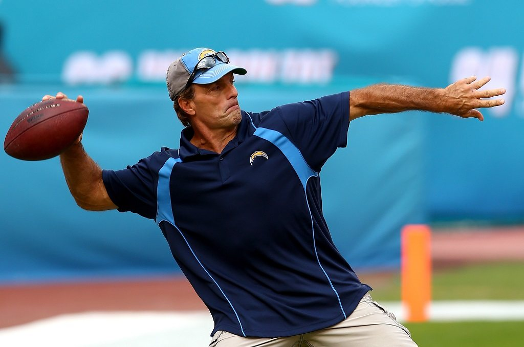 Doug Flutie warms up with a pass before the game.