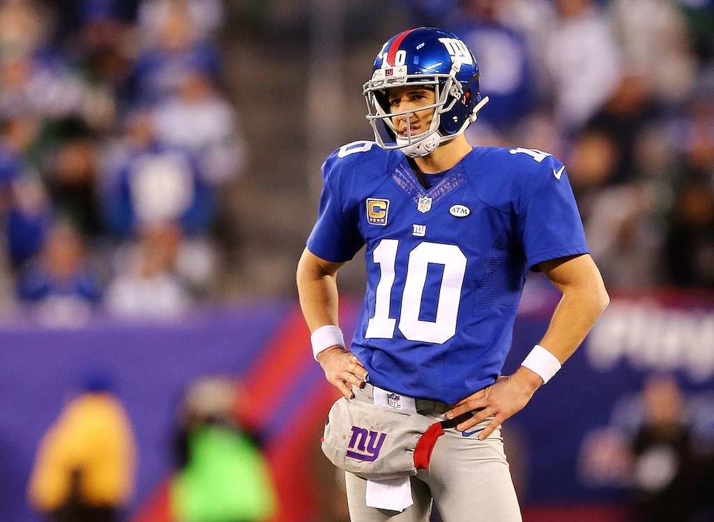Eli Manning stands on the field between plays.