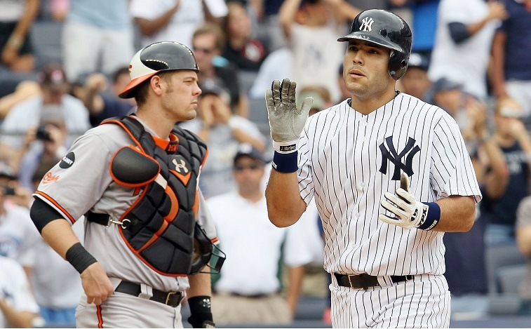 NEW YORK, NY - SEPTEMBER 05: Jesus Montero #63 of the New York Yankees celebrates his fifth inning home run as Matt Wieters #32 of the Baltimore Orioles looks on at Yankee Stadium on September 5, 2011 in the Bronx borough of New York City. The home run was the first in the major leagues for Montero. (Photo by Jim McIsaac/Getty Images)