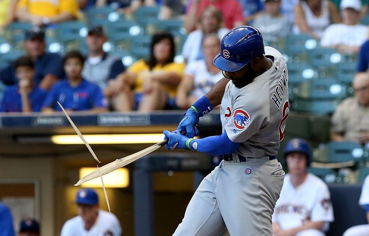 Jason Heyward of the Chicago Cubs breaks his bat.