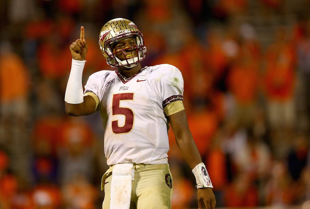 The Florida State Seminoles hold up their fingers indicating that they're No. 1.