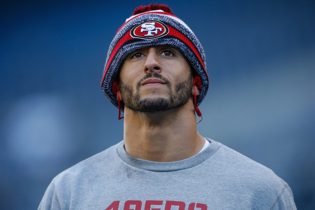 Colin Kaepernick stands on the sidelines | Otto Greule Jr./Getty Images